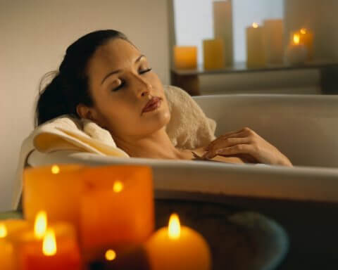 woman in bath with soothing bath oils
